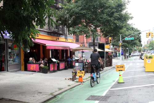 Slow  restaurant-posted bike-lane signage  Rancho Tequileria  Amsterdam Ave  Manhattan