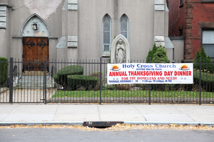 Annual Thanksgiving Day Dinner for the homeless and needy  banner outside Holy Cross Church  Flatbush  Brooklyn