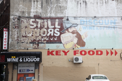 D'Still Liquors  surviving signage above The Lieutenant Spirits Wine & Liquor  Bensonhurst  Brooklyn