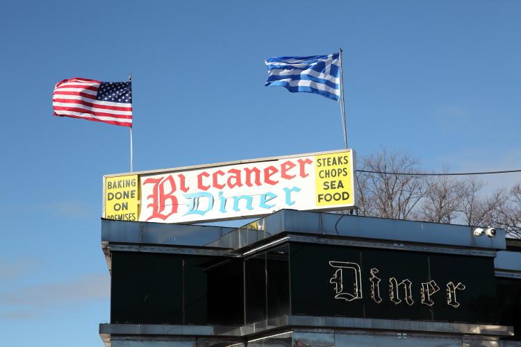 US and Greek flags flying over teh Buccaneer Diner  East Elmhurst  Queens