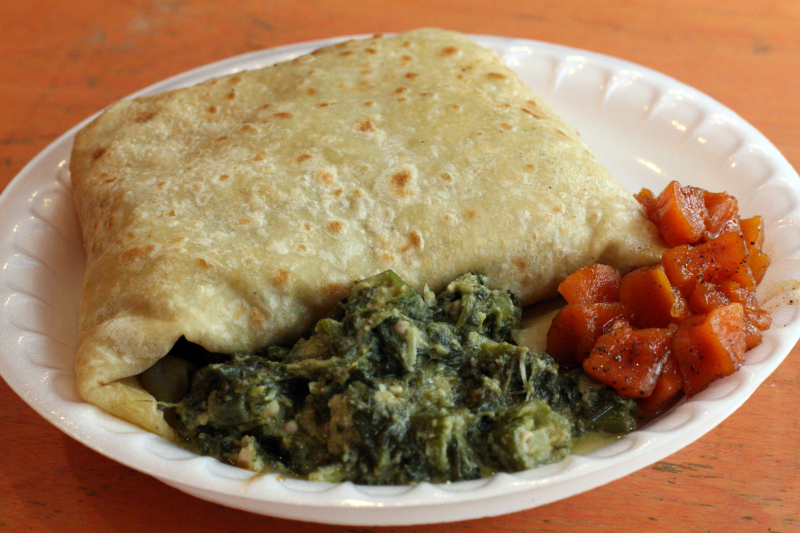 Goat roti  with callaloo and sweet potato  at Sisters Restaurant  East 124th Street  New York