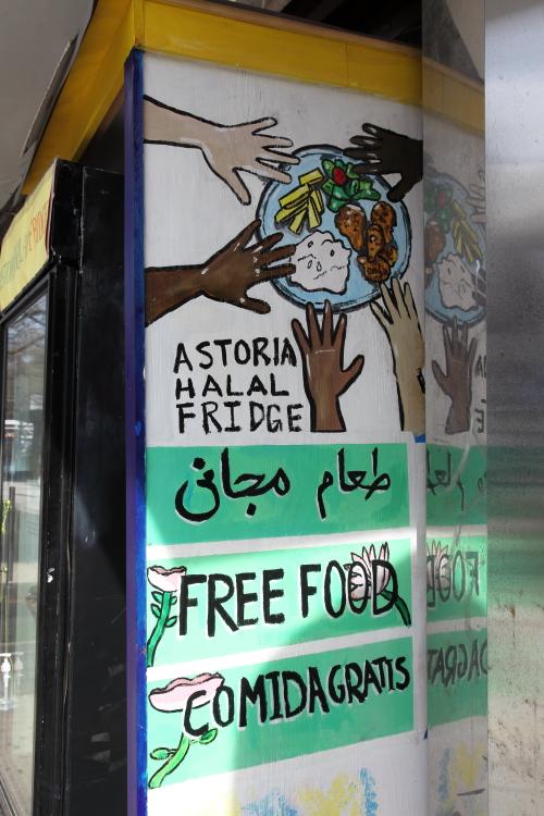Free food  hand-drawn signage in Arabic  English  and Spanish  Astoria Halal Fridge  Astoria  Queens