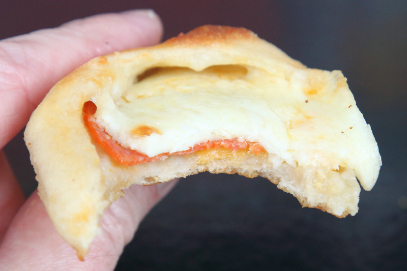 Cheese-and-pepperoni roll (biteaway view)  Riossi Pizza  Broadway  Manhattan