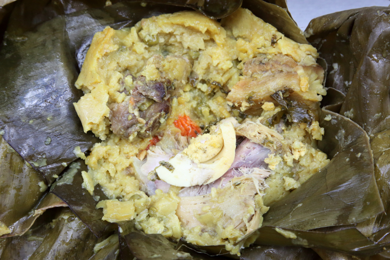 Tamal Tolimense (unwrapped and partially excavated)  Son D'licias  Jackson Heights  Queens