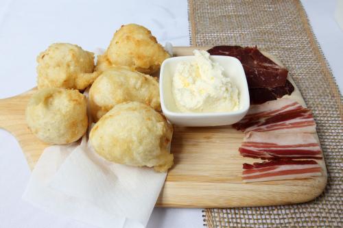 Ustipci with kajmak  prosciutto  and Serbian bacon  Selo Restaurant  Astoria  Queens